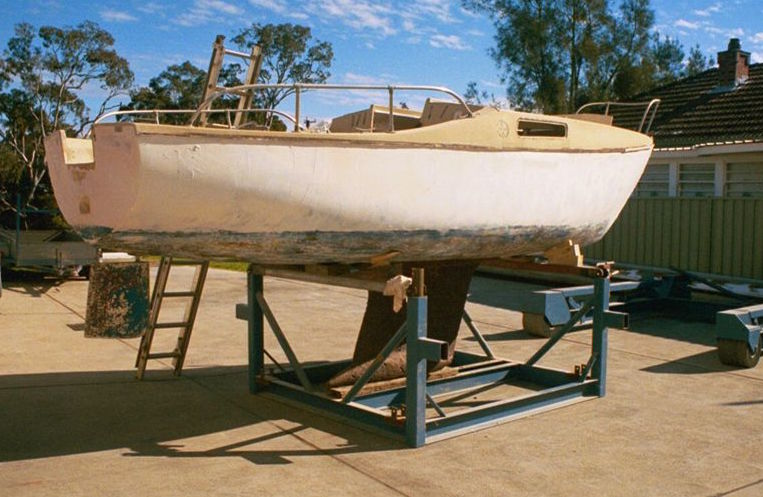 boat on hard stand before painting and repairs 01