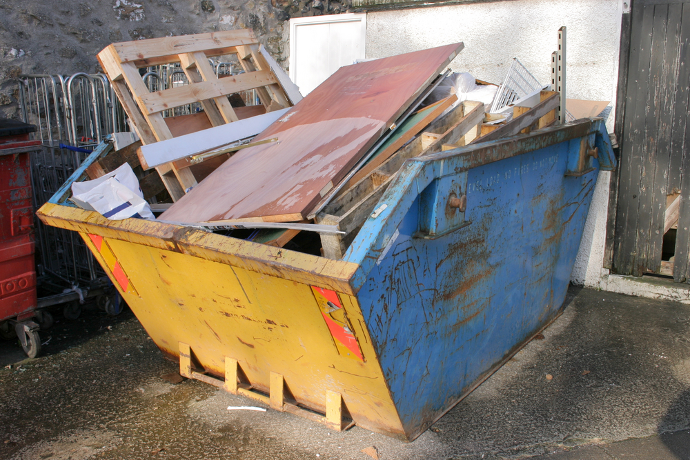 skip bin with timber from boat building and construction