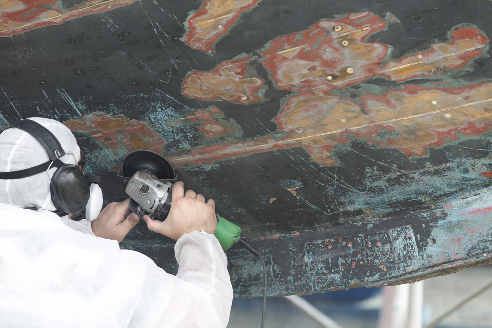 using a grinder to repair a boat hull