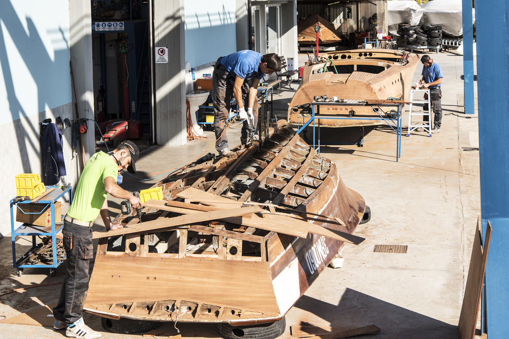 shipwrights working on a timber hull