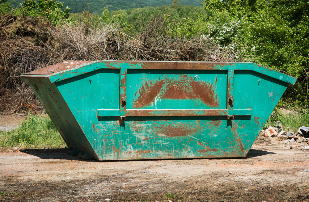 skip bin at a ship yard for builders waste